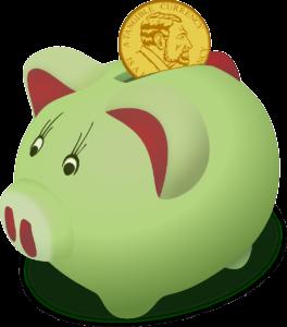 tirelire cochon verte avec pièce de monnaie